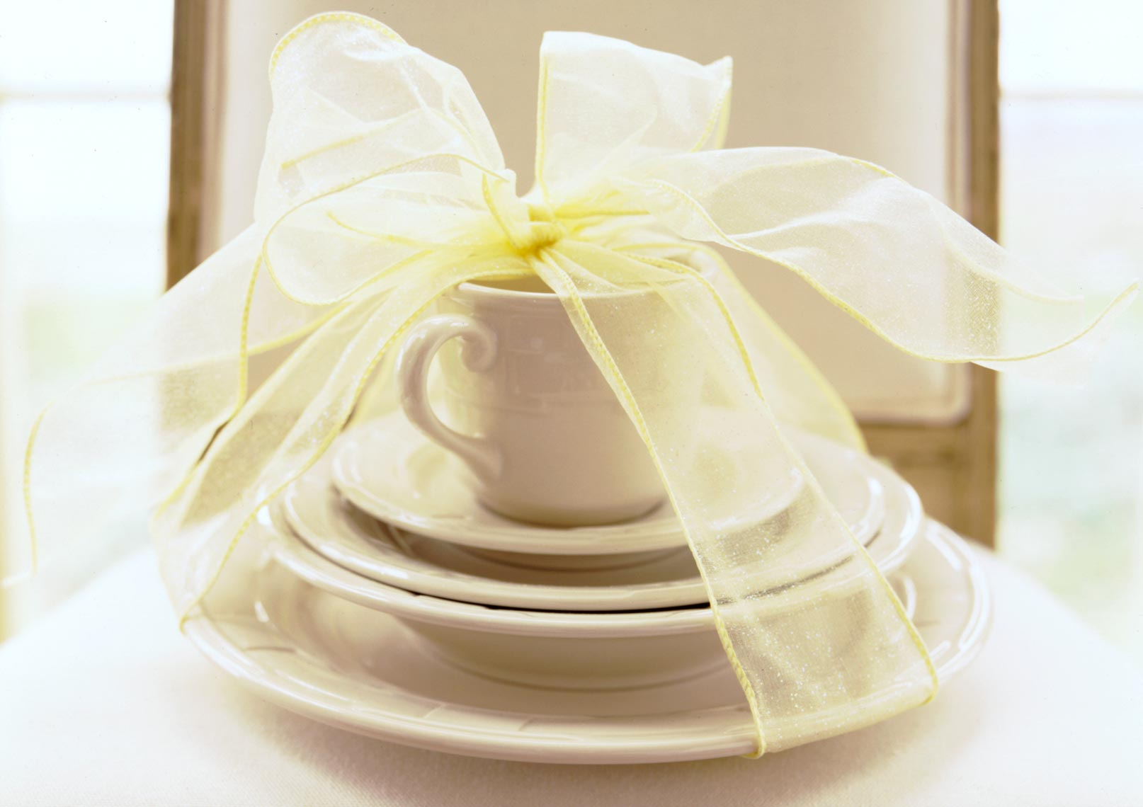Dish set with yellow ribbon on top